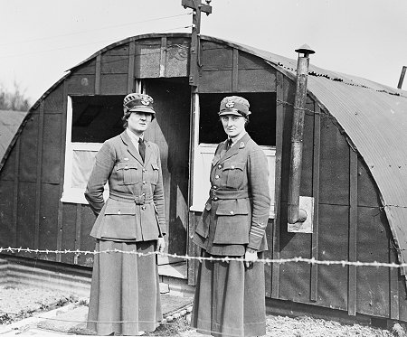 Two medical officers of the Womens Royal Air Force outside the later pattern hut that supplemented the earlier Army square huts
